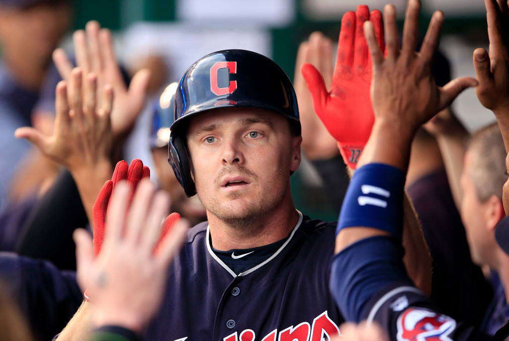 . Cleveland Indians\' Jay Bruce celebrates with teammates following his two-run home run off Kansas City Royals starting pitcher Ian Kennedy during the first inning of a baseball game at Kauffman Stadium in Kansas City, Mo., Friday, Aug. 18, 2017. (AP Photo/Orlin Wagner)
