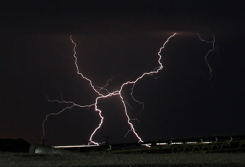 . Lightning strikes and lights up the skies as monsoon storms pass throughout the high deserts area early Monday morning, Aug. 19, 2013 - Newberry Springs CA. Photo by Gene Blevins/LA Daily News