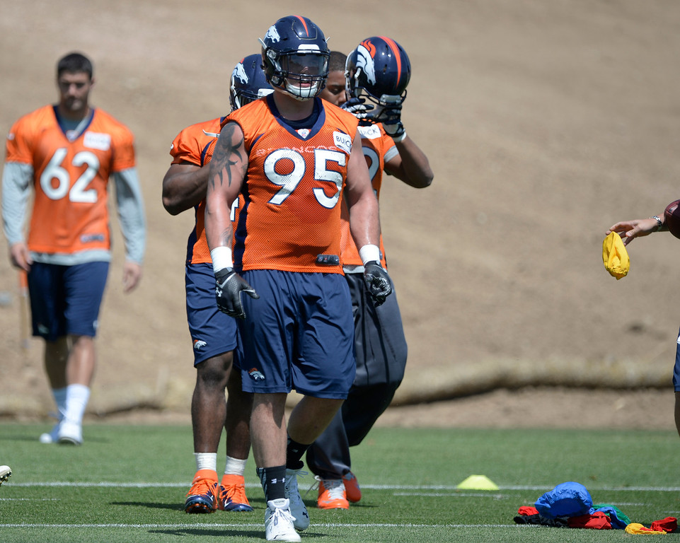 . Denver Broncos Derek Wolfe (95) heads to drills during OTAs June 10, 2014 at Dove Valley. (Photo by John Leyba/The Denver Post)