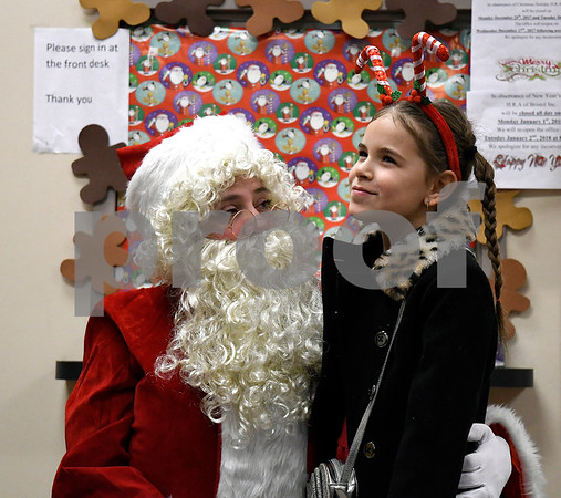 12/15/2017 Mike Orazzi | Staff Bella Nuzzo,7, thinks about what she may want for Christmas during a Christmas party Friday afternoon in Bristol at the Human Resources Agency of Bristol.