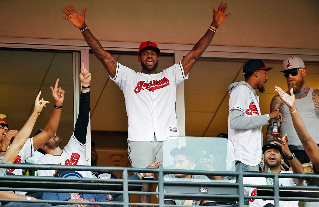 . Cleveland Cavaliers\' LeBron James stands during the seventh inning in Game 2 of baseball\'s American League Championship Series between the Cleveland Indians and the Toronto Blue Jays in Cleveland, Saturday, Oct. 15, 2016. (AP Photo/Gene J. Puskar)