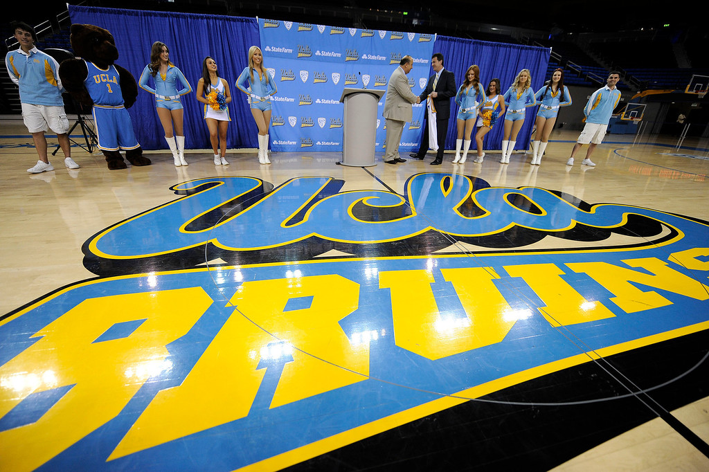 . UCLA athletic director Dan Guerrero shakes hands with new men\'s basketball coach Steve Alford during during a press conference at Pauley Pavillion on the UCLA campus Tuesday, April 2, 2013. (Hans Gutknecht/Staff Photographer)