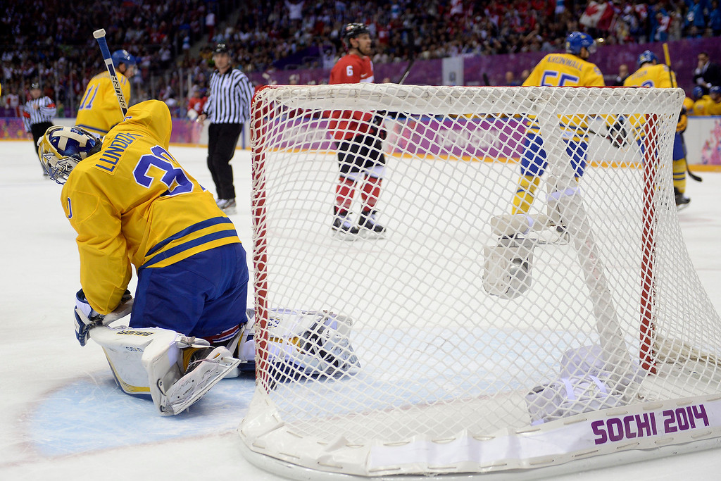 . Henrik Lundqvist (30) of Sweden reacts to giving up the first goal of the game to Jonathan Toews (16) of Canada during the first period of the men\'s ice hockey gold medal game. Sochi 2014 Winter Olympics on Sunday, February 23, 2014 at Bolshoy Ice Arena. (Photo by AAron Ontiveroz/ The Denver Post)