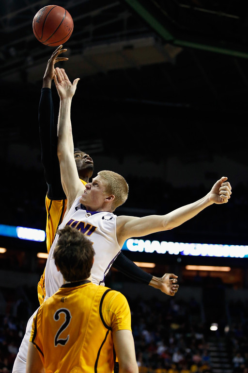 . Derek Cooke Jr. #11 of the Wyoming Cowboys fouls Nate Buss #14 of the Northern Iowa Panthers  during the second round of the 2015 Men\'s NCAA Basketball Tournament at KeyArena on March 20, 2015 in Seattle, Washington.  (Photo by Ezra Shaw/Getty Images)