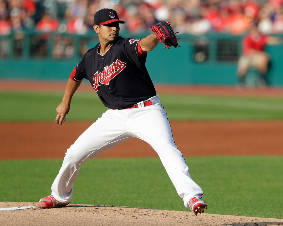 . Cleveland Indians starting pitcher Carlos Carrasco delivers in the first inning of a baseball game against the Cincinnati Reds, Wednesday, July 11, 2018, in Cleveland. (AP Photo/Tony Dejak)