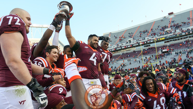 The Hokies celebrate their win over UVa. (Mark Umansky/TheKeyPlay.com)