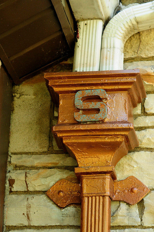 ". An ""S\"" decorates a down spout of the home which Harold Stassen owned when he was Governor of Minnesota."