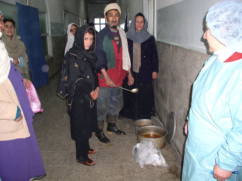 This gentleman is the cook for the hospital and he is serving lunch to the patients. He is widowed and has 4 small children, all under the age of 7. He received a bag of shoes for his children. I believe he is also wearing one of Mr. Cosimano's donated jackets.