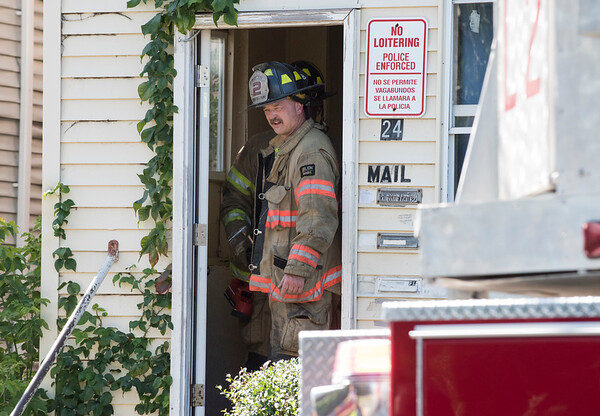 09/25/19 Wesley Bunnell | StaffrrA fire on the first floor of 24 Oak St was quickly knocked down by firefighters on Wednesday afternoon. A firefighter stands in the entrance to 24 Oak.