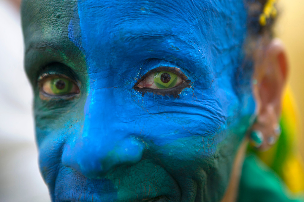 . A fan wears contact lenses with the flag of Brazil prior to the start of the Mexico vs Brazil match inside the FIFA Fan Fest during the 2014 soccer World Cup in Sao Paulo, Brazil, Tuesday, June 17, 2014.  (AP Photo/Dario Lopez-Mills)