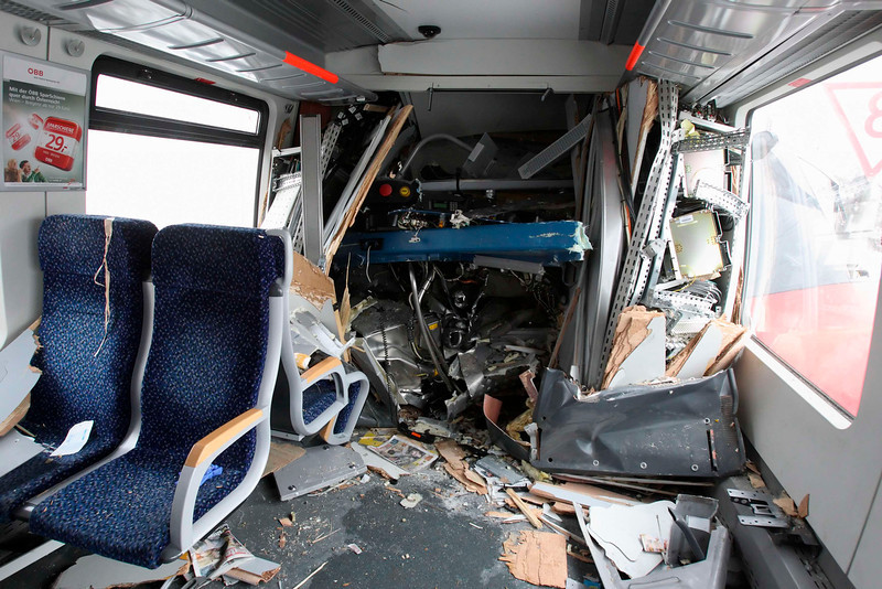 . A view inside a demolished S45 train where it was frontally hit by another after a train crash in Vienna January 21, 2013. Two trains collided Monday morning, injuring 25 people, police said. REUTERS/Heinz-Peter Bader (AUSTRIA)