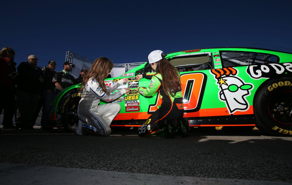 Description of . Danica Patrick, driver of the #10 GoDaddy.com Chevrolet, poses with Ms. Coors Light, Rachel Rupert, after qualifying for the NASCAR Sprint Cup Series Daytona 500 at Daytona International Speedway on February 17, 2013 in Daytona Beach, Florida.  (Photo by Jonathan Ferrey/Getty Images)