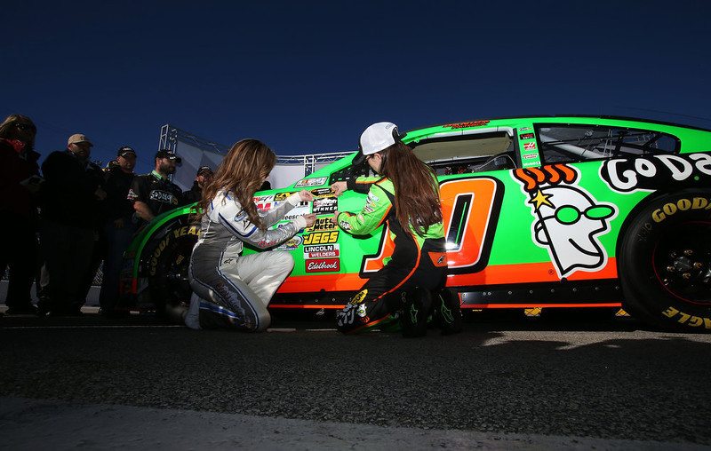 . Danica Patrick, driver of the #10 GoDaddy.com Chevrolet, poses with Ms. Coors Light, Rachel Rupert, after qualifying for the NASCAR Sprint Cup Series Daytona 500 at Daytona International Speedway on February 17, 2013 in Daytona Beach, Florida.  (Photo by Jonathan Ferrey/Getty Images)