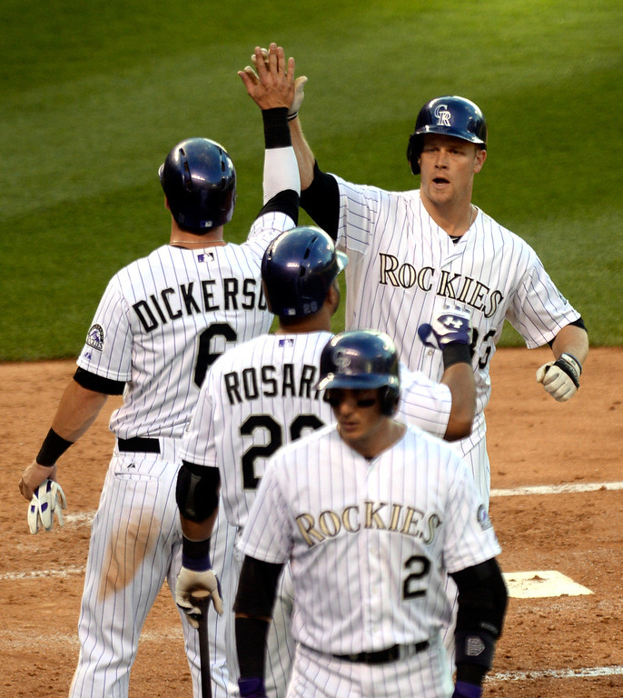 . DENVER, CO - JUNE 20: Colorado\'s Justin Morneau slapped hands with teammates following his second inning home run that put the Rox up 6-4. The Colorado Rockies hosted the Milwaukee Brewers at Coors Field Friday night, June 20, 2014. Photo by Karl Gehring/The Denver Post