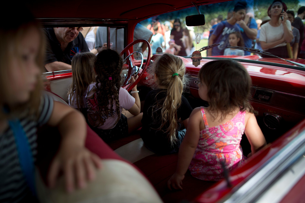 ". Children sit in their grandfather\'s antique car during the 31st annual ""Five Club\"" collectors car meeting in Ramat Gan, Israel, Friday, Oct. 6, 2017. (AP Photo/Oded Balilty)"