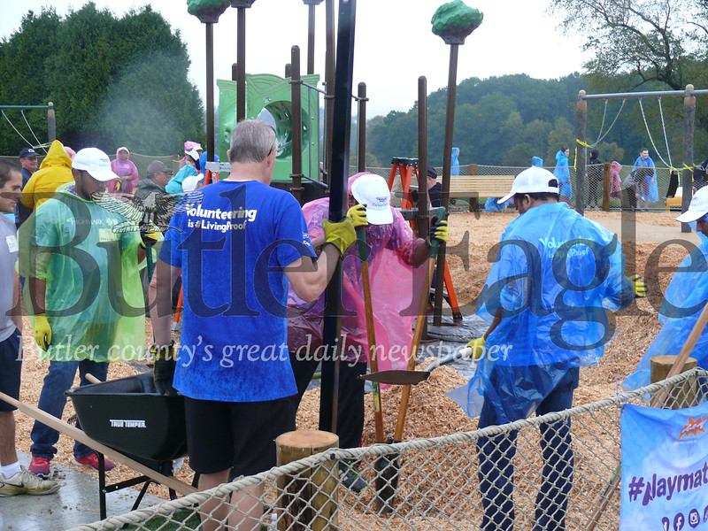 Volunteers work on the site of a new playground at North Boundary Park in Cranberry Township.