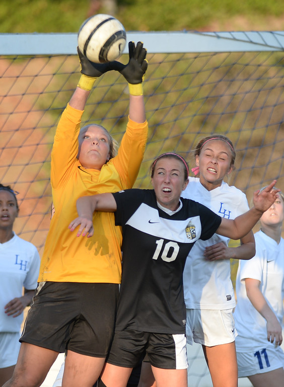 . La Habra goal keeper Katelyn Phinney grabs a corner kick as they play Sunny Hills in their girls soccer game at La Habra High School on Thursday January 16, 2014. Sunny Hills defeated La Habra 2-0. (Staff Photo by Keith Durflinger/San Gabriel Valley Tribune)