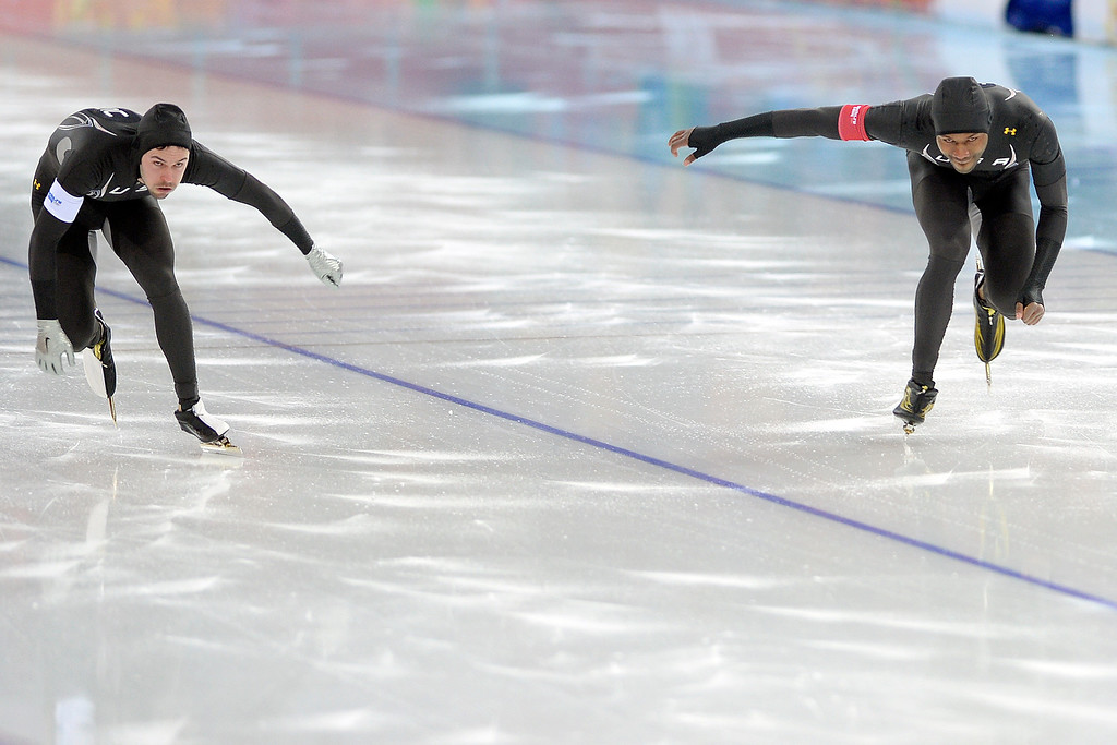 . United States racers Mitchell Whitmore (left) and Shani Davis finish their second race during the speed skating men\'s 500-meter at Adler Arena. Sochi 2014 Winter Olympics on Monday, February 10, 2014. (Photo by AAron Ontiveroz/The Denver Post)