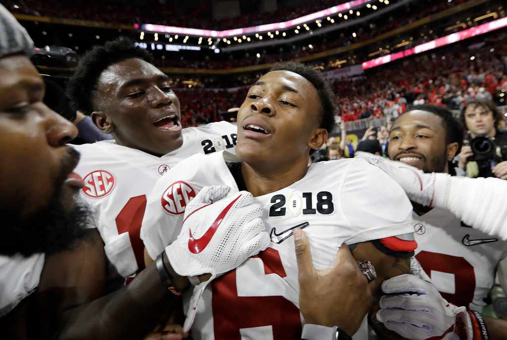 . Alabama\'s DeVonta Smith (6) celebrates with team mates after overtime of the NCAA college football playoff championship game against Georgia Monday, Jan. 8, 2018, in Atlanta. Alabama won 26-23. (AP Photo/David J. Phillip)