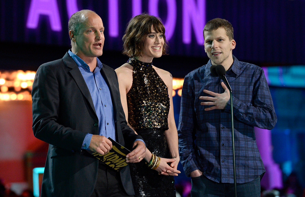 . Woody Harrelson, from left, Lizzy Caplan and Jesse Eisenberg present the award for best action performance at the MTV Movie Awards at Warner Bros. Studio on Saturday, April 9, 2016, in Burbank, Calif. (Kevork Djansezian/Pool Photo via AP)