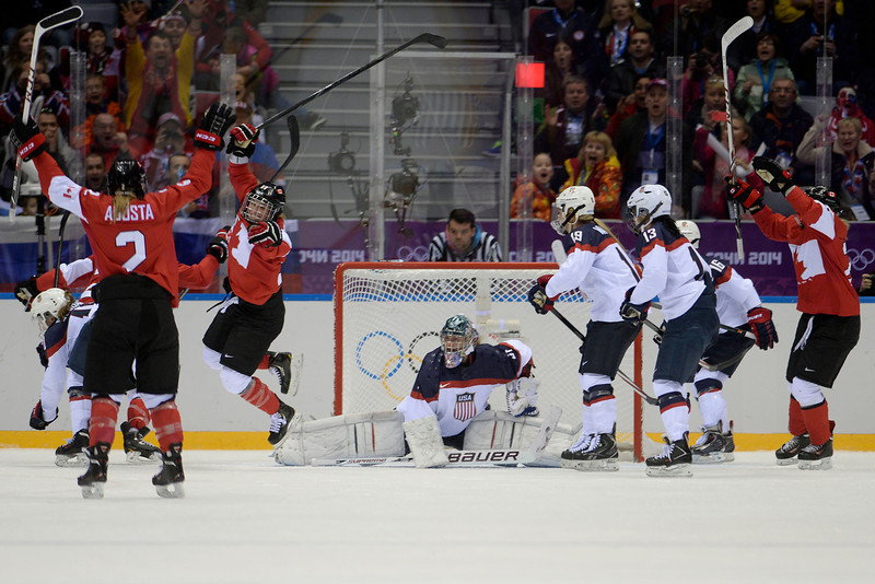 . Marie-Philip Poulin (29) of the Canada jumps into the air after tying the game 2-2 on against the U.S.A. during the third period of the women\'s gold medal ice hockey game. Sochi 2014 Winter Olympics on Thursday, February 20, 2014 at Bolshoy Ice Arena. (Photo by AAron Ontiveroz/ The Denver Post)