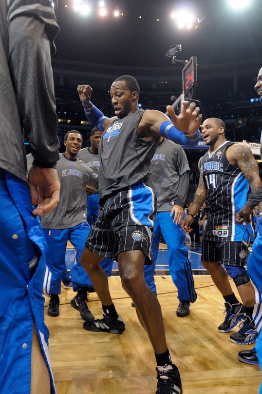 . Orlando Magic center Dwight Howard, center, performs a dance in the middle of a huddle after player introductions prior to an NBA basketball game against the Chicago Bulls in Orlando, Fla., Monday, March 19, 2012.(AP Photo/Phelan M. Ebenhack)