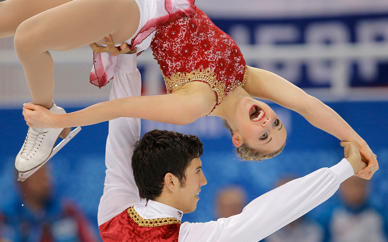 . Paige Lawrence and Rudi Swiegers of Canada compete in the pairs free skate figure skating competition at the Iceberg Skating Palace during the 2014 Winter Olympics, Wednesday, Feb. 12, 2014, in Sochi, Russia. (AP Photo/Vadim Ghirda)