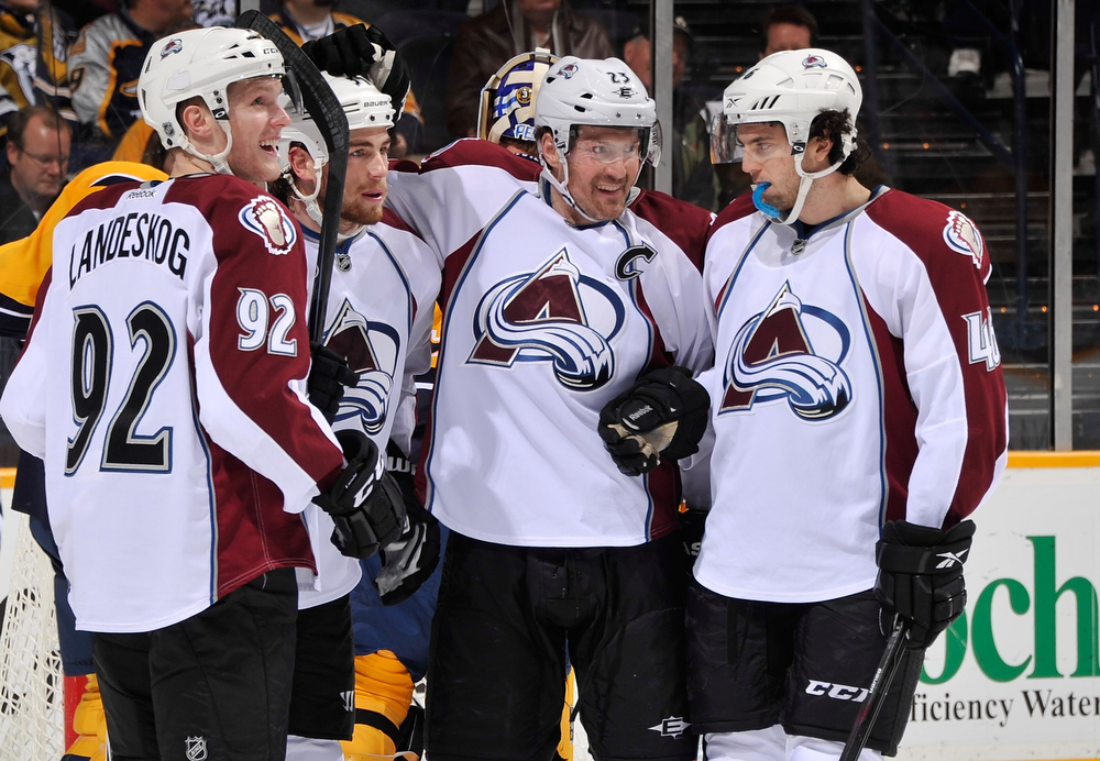 . Gabriel Landeskog #92, Ryan O\'Reilly #37, Milan Hejduk #23, and Stefan Elliott #46 of the Colorado Avalanche celebrate after a goal against the Nashville Predators at the Bridgestone Arena on January 12, 2012 in Nashville, Tennessee.  (Photo by Frederick Breedon/Getty Images)