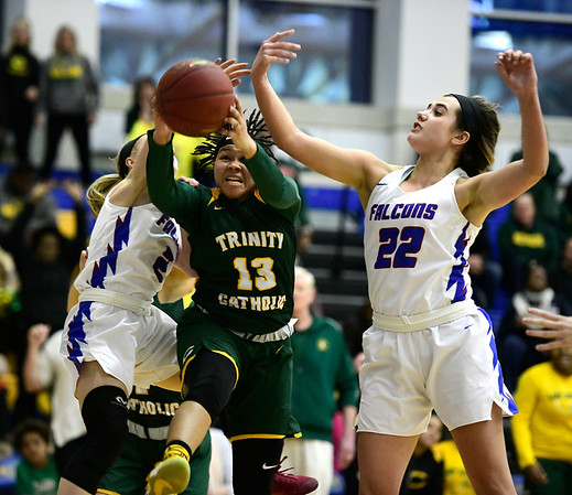 3/8/2019 Mike Orazzi   Staff St. Paul Catholic High School's Kailyn Bielecki (2) and Morgan Kolb (22) with Trinity Catholic's Caitlyn Scott (13) during the Class S Semifinal girls basketball game at Newtown High School Friday night in Newtown.