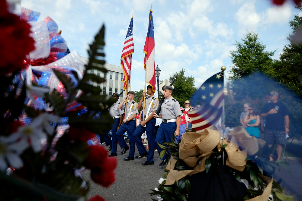 . Members of Evans High School\'s JROTC present the colors during a ceremony honoring all three of Georgia\'s Signers of the Declaration of Independence and the final resting place of two of them on Friday, July 4, 2014, in Augusta, Ga. (AP Photo/The Augusta Chronicle, Todd Bennett)