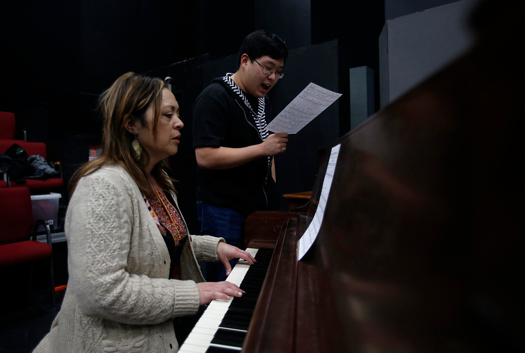 . Joo Jun, right, sings with while Dolores Duran, musical director for Great America, plays the piano during her audition during a casting call for Great America theme park for their various characters and dancers in Hall Todd Theatre at San Jose State University on Wednesday, Feb. 6, 2013.  (Nhat V. Meyer/Staff)