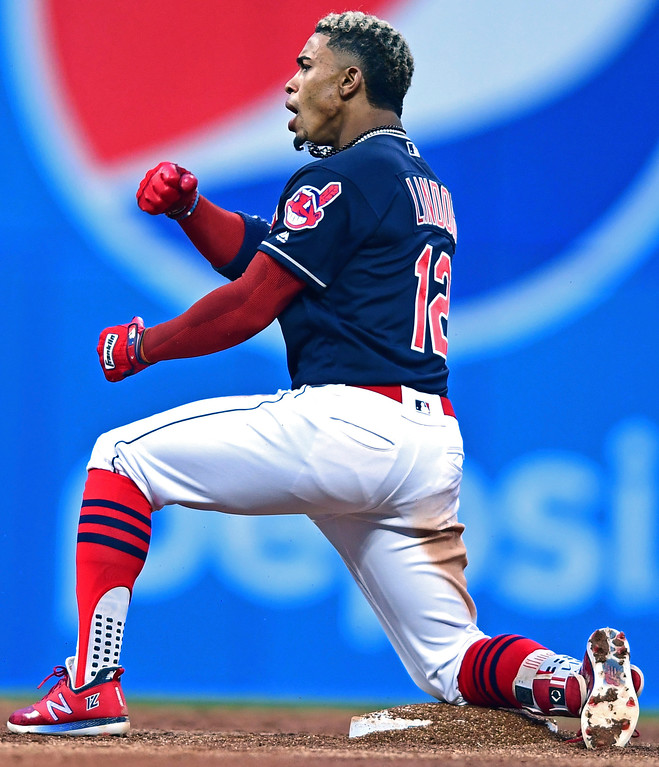 . Cleveland Indians\' Francisco Lindor celebrates after hitting an RBI-double during the second inning of the team\'s baseball game against the Toronto Blue Jays, Friday, April 13, 2018, in Cleveland. (AP Photo/David Dermer)