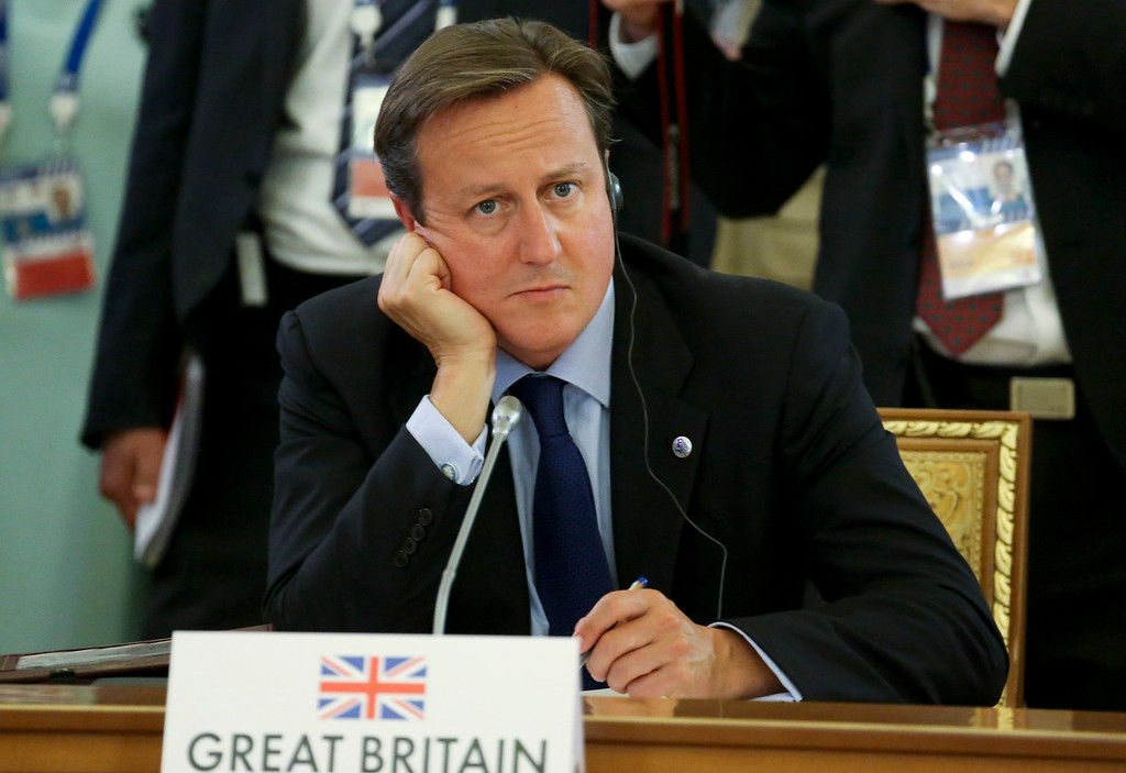 . Britain\'s Prime Minister David Cameron listens to statements during a round table meeting at the G-20 summit in St. Petersburg, Russia on Thursday, Sept. 5, 2013. (AP Photo/Sergei Karpukhin, Pool)