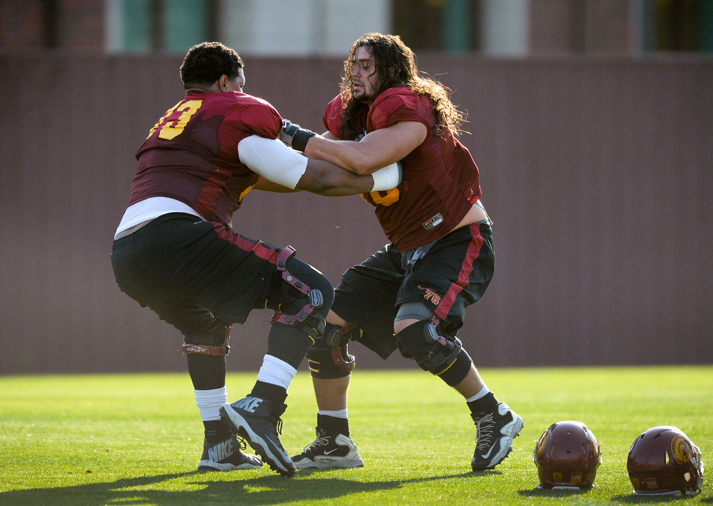 . USC offensive linemen Zach Banner, left, and Nathan Guertler do a drill at practice, Thursday, March 27, 2014, at USC. (Photo by Michael Owen Baker/L.A. Daily News)