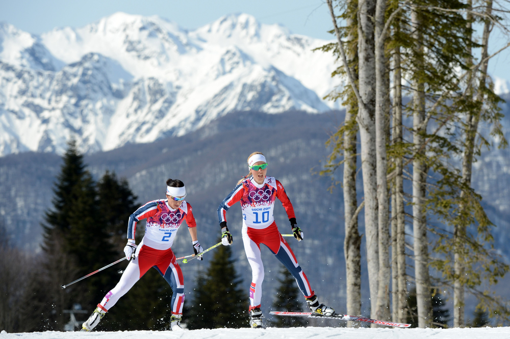 . Norway\'s Marit Bjoergen (2) and Norway\'s Kristin Stoermer Steira compete in the Women\'s Cross-Country Skiing 30km Mass Start Free at the Laura Cross-Country Ski and Biathlon Center during the Sochi Winter Olympics on February 22, 2014, in Rosa Khutor, near Sochi. (KIRILL KUDRYAVTSEV/AFP/Getty Images)