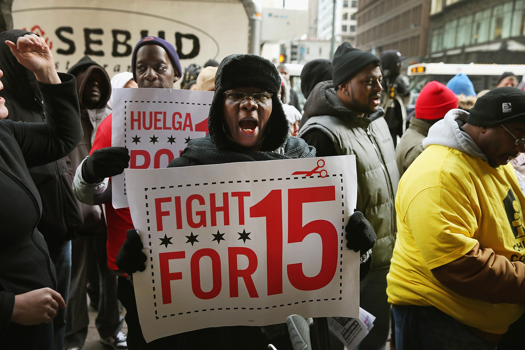. Demonstrators demanding an increase in pay for fast-food and retail workers protest outside a Sears store in the Loop on December 5, 2013 in Chicago, Illinois.  (Photo by Scott Olson/Getty Images)