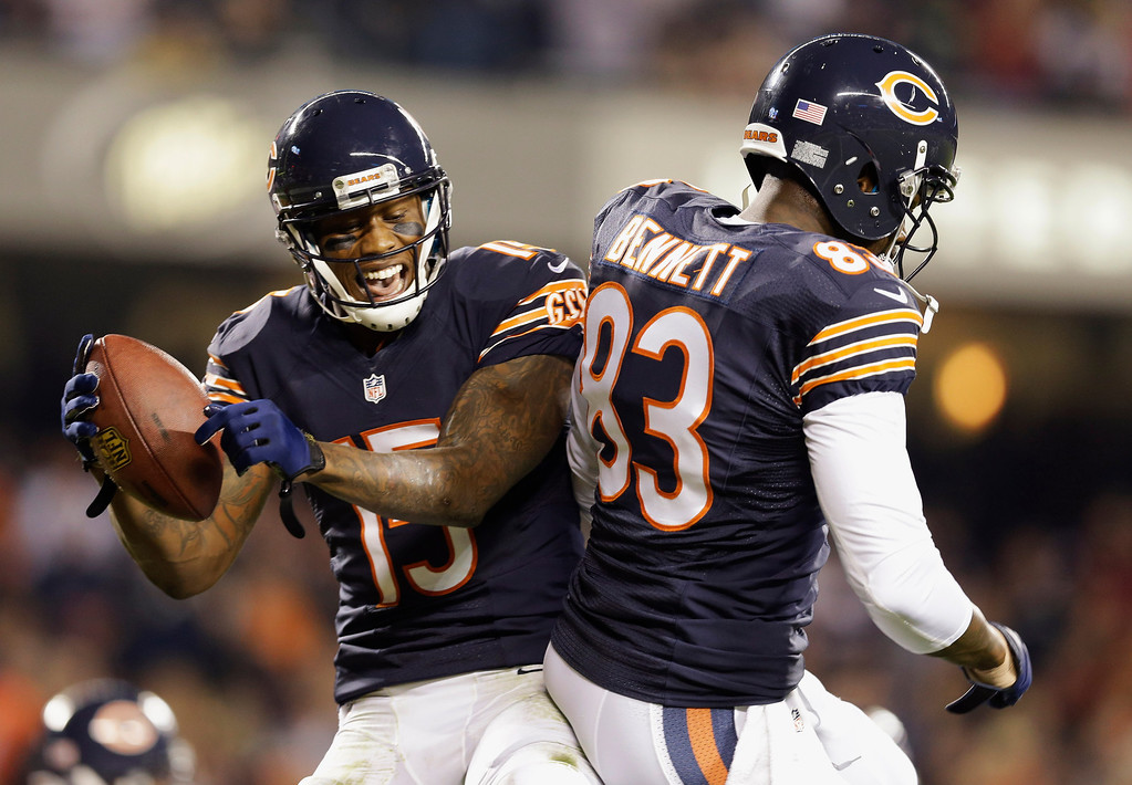 . Chicago Bears wide receiver Brandon Marshall (15) celebrates his touchdown reception with tight end Martellus Bennett (83) in the first half of an NFL football game against the New York Giants, Thursday, Oct. 10, 2013, in Chicago. (AP Photo/Nam Y. Huh)