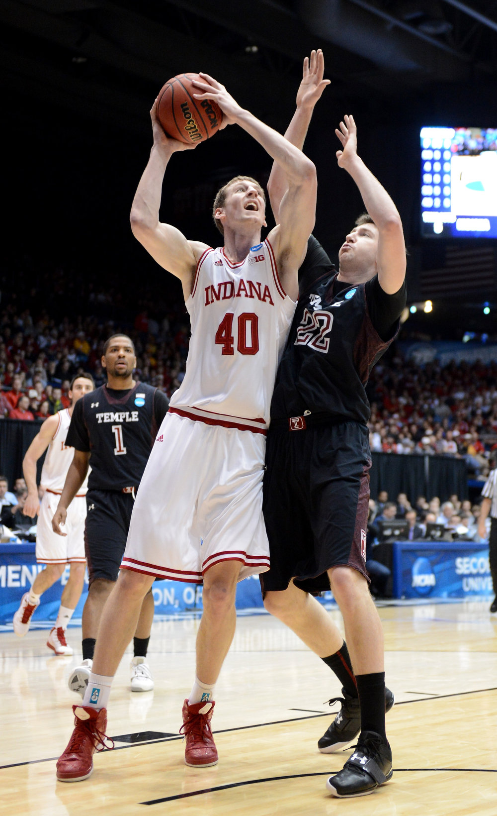 . Cody Zeller #40 of the Indiana Hoosiers drives to the basket against Jake O\'Brien #22 of the Temple Owls in the first half during the third round of the 2013 NCAA Men\'s Basketball Tournament at UD Arena on March 24, 2013 in Dayton, Ohio.  (Photo by Jason Miller/Getty Images)