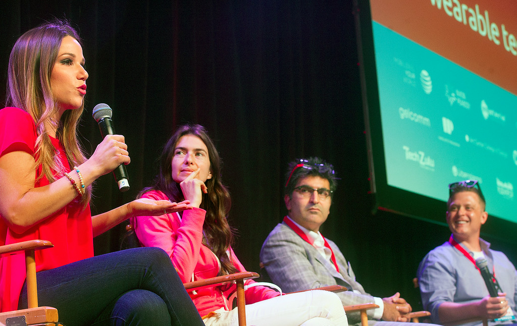 . Stuart Brazell, left,  TV Host/Producer on discussion panel on smart eye glasses, with Janet Hansen, Founder & Chief,  Kayvan Mirza, Optinvent CEO, and Erick Miller, Founder & CEO, Epiphany Eyewear. Wearable Tech LA is the first entertainment and health wearable conference held in Los Angeles. The event showcased wearable technology, which is currently the fastest growing category in technology July 17, 2014 at the Pasadena Convention Center.(Photo by Walt Mancini/Pasadena Star-News)