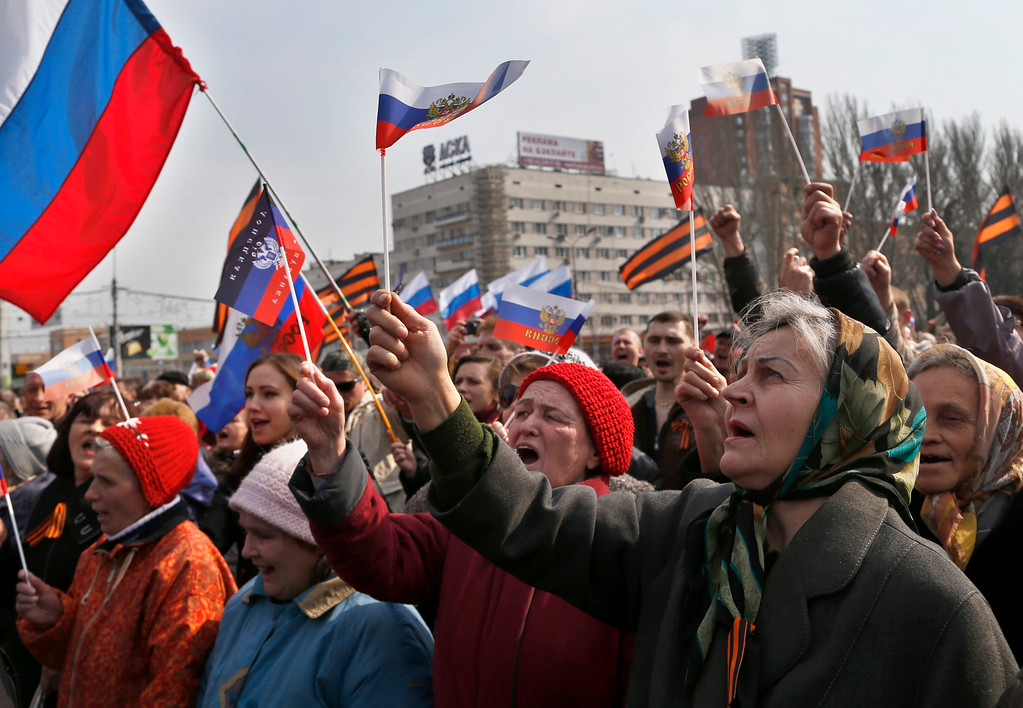 . People shout slogans during a pro Russian rally at a central square in Donetsk, eastern Ukraine, Saturday, March 15, 2014. Russian forces backed by helicopter gunships and armored vehicles Saturday took control of a village near the border with Crimea on the eve of a referendum on whether the region should seek annexation by Moscow, Ukrainian officials said. (AP Photo/Sergei Grits)