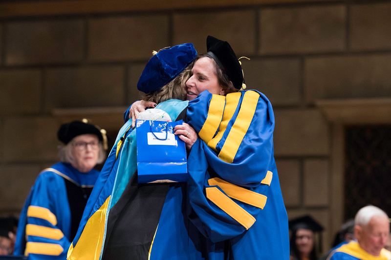 Alison H. Simpson, the SON's 150th PhD, gets a hug from Dean Kathy Rideout. // University of Rochester School of Nursing Commencement, Kodak Hall at Eastman Theatre May 17, 2019.  // photo by J. Adam Fenster / University of Rochester
