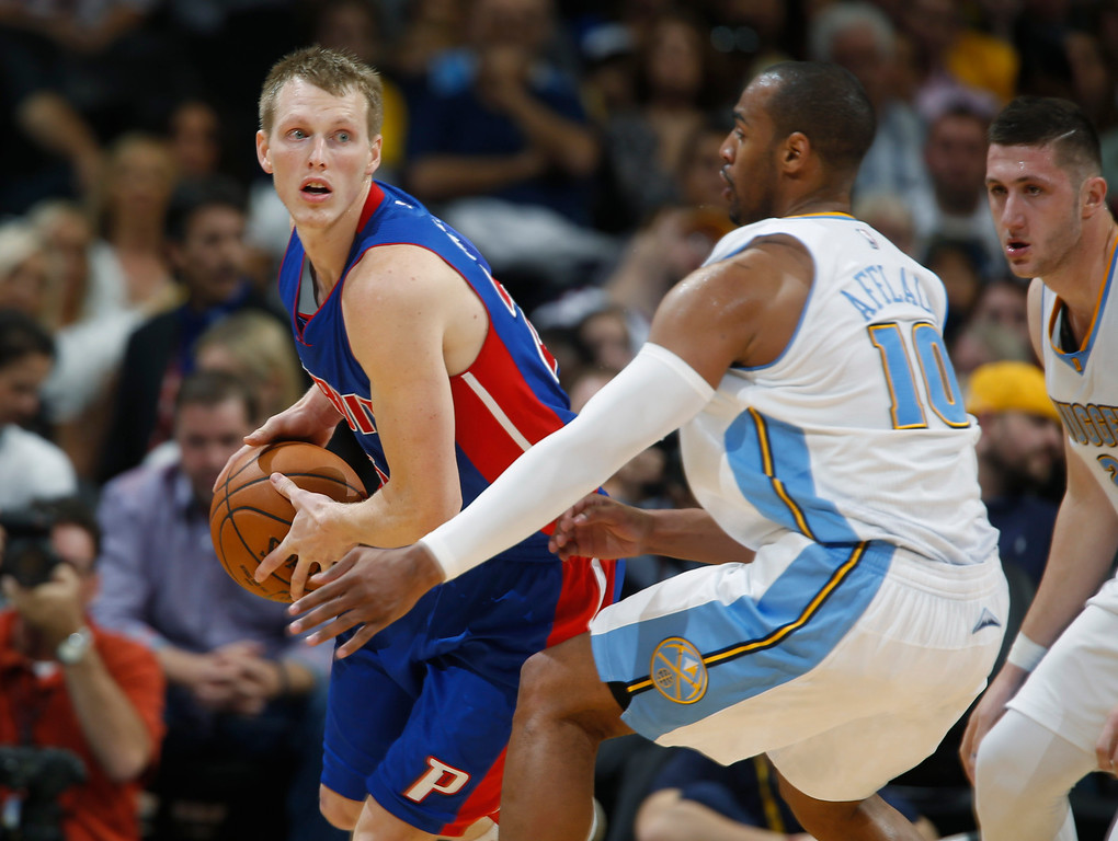 . Detroit Pistons forward Kyle Singler, left, gets trapped in the corner with the ball by Denver Nuggets guard Arron Afflalo in the third quarter of the Nuggets\' 89-79 victory in an NBA basketball game in Denver on Wednesday, Oct. 29, 2014. (AP Photo/David Zalubowski)