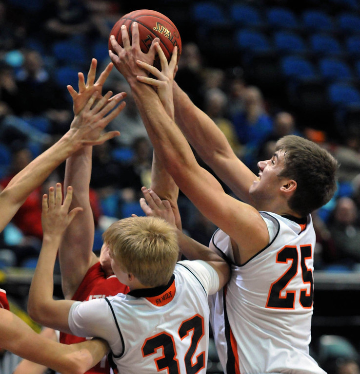 . Grand Rapid\'s Alex Illikainen, right, grabs a rebound over the outstretched arms of teammate Hunter Dubbels and a Lakeville North player,  in the second  half. (Pioneer Press: Scott Takushi)