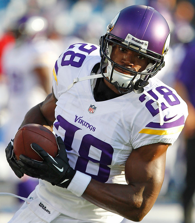 . Minnesota Vikings running back Adrian Peterson (28) warms up before an NFL preseason football game against the Buffalo Bills Friday, Aug. 16, 2013, in Orchard Park, N.Y.  (AP Photo/Bill Wippert)