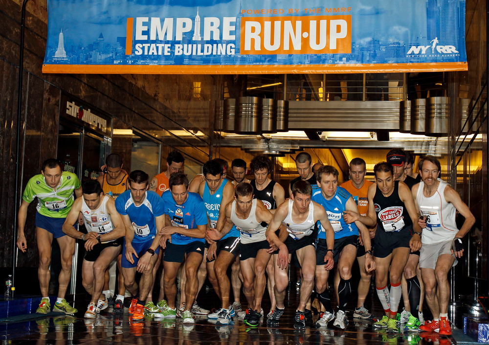 . The men\'s invitational runners prepare to start the 36th Empire State Building Run-Up running race in New York, February 6, 2013. Competitors run up 1,576 steps and 1,050 feet in a stairwell from the ground floor to the 86th floor observation deck.   REUTERS/Adam Hunger