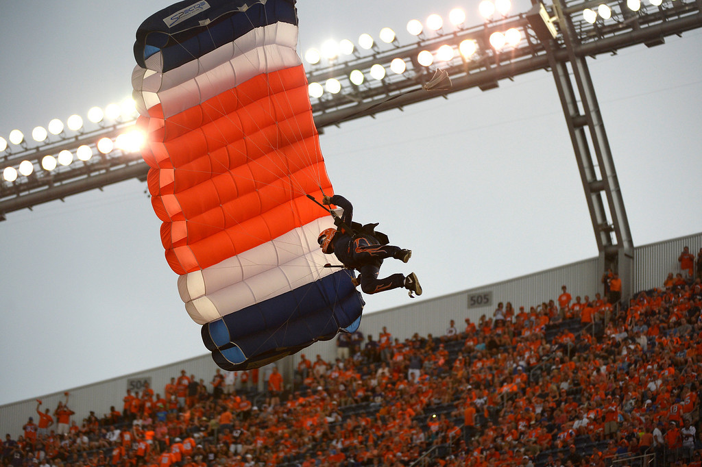 . Parachutists enter the stadium and land on the field before the game begins.  (Photo by Joe Amon/The Denver Post)
