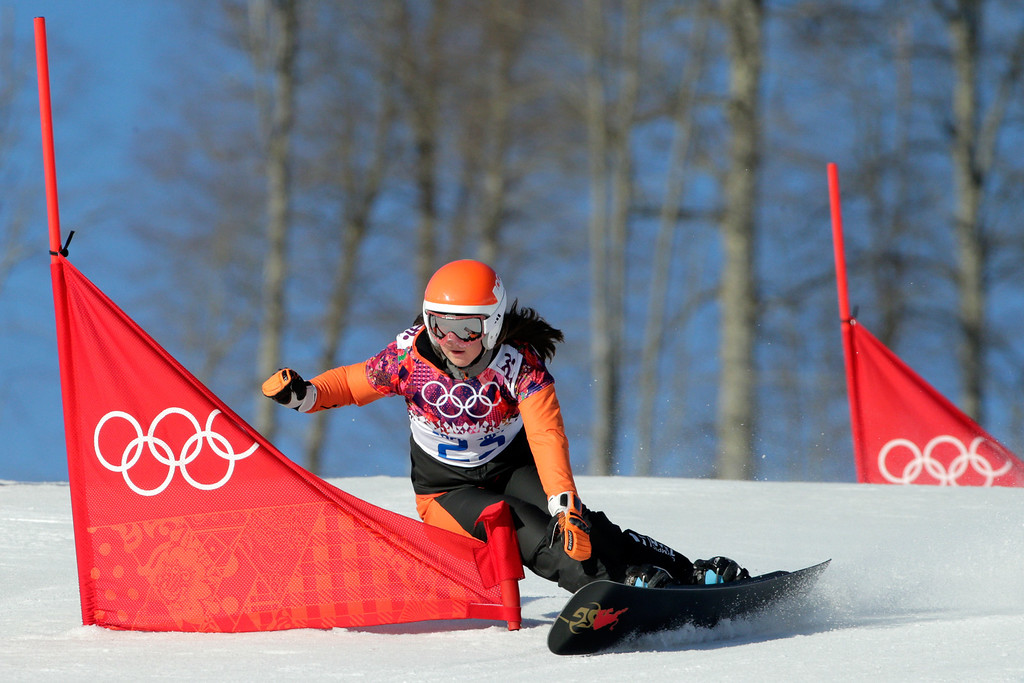 . SOCHI, RUSSIA - FEBRUARY 22: Michelle Dekker of Netherlands competes in the Snowboard Ladies\' Parallel Slalom Qualification on day 15 of the 2014 Winter Olympics at Rosa Khutor Extreme Park on February 22, 2014 in Sochi, Russia.  (Photo by Adam Pretty/Getty Images)
