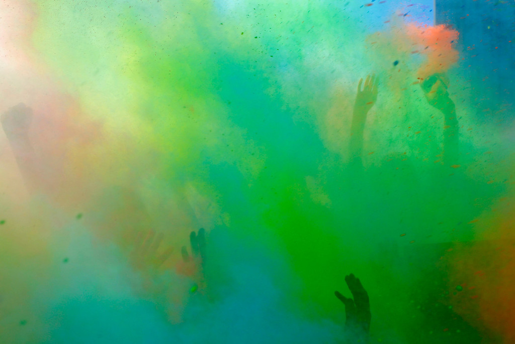 . People hands are seen as they  throw paint powder in the air during the holi one colour Festival held in the city of Cape Town , South Africa, Saturday, March 2, 2013. Thousands of people took part in the festival by throwing coloured paint powder at each other to express freedom and the colour of everyday life. (AP Photo/Schalk van Zuydam)