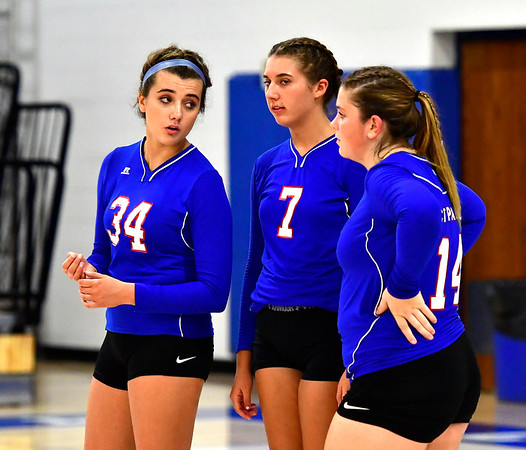 9/27/2018 Mike Orazzi | Staff St. Paul Volleyball's Morgan Kolb (34), Rebecca Nerbonne (7) and Megan Fortier (14) Thursday night in Bristol.