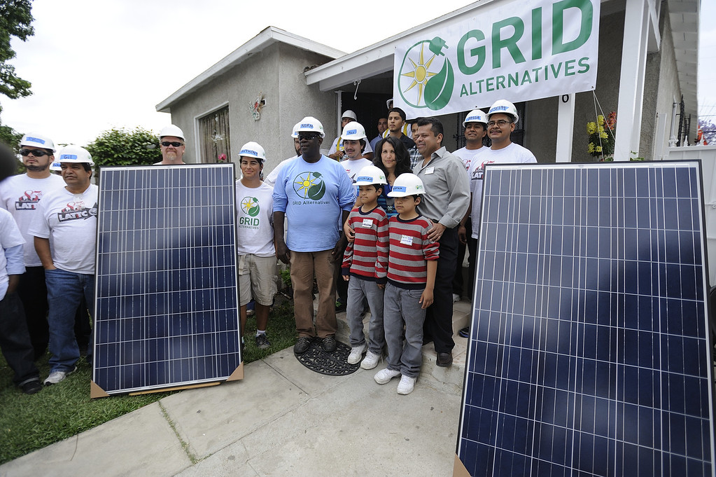 . LONG BEACH, CALIF. USA -- Workers and family members pose for a picture before a solar panel installation on a north Long Beach (Calif.) home on Friday, May 17, 2013. This is the sixth family on this North Long Beach block to be assisted by the Single-family Affordable Solar Homes Program. This installation will allow the homeowners to save up to 90% on their electricity bills. Photo by Jeff Gritchen / Los Angeles Newspaper Group